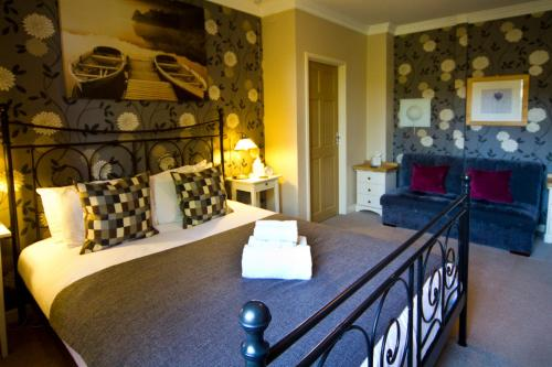 A bed or beds in a room at Eight Bells Inn