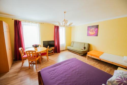 Гостиная зона в Medainie apartamenti