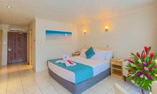 A bed or beds in a room at Muri Beach Club Hotel