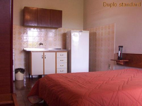 Cama ou camas em um quarto em Residencial Sol e Mar de Floripa