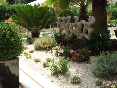 A garden outside Hotel Diana