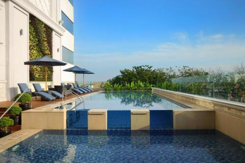 The swimming pool at or near Four Points by Sheraton Medan