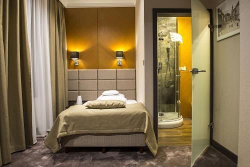 Łóżko lub łóżka w pokoju w obiekcie Hotel Europa