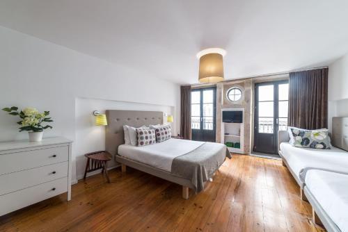 Uma cama ou camas num quarto em Comercio do Porto by Oporto Tourist Apartments