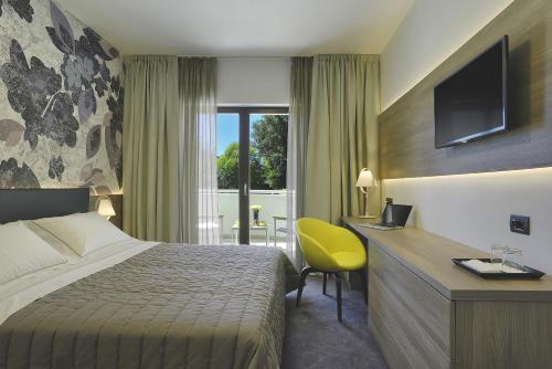 A bed or beds in a room at Residence Rovinj