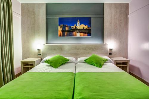 Cama o camas de una habitación en Hotel Spa Rio Ucero