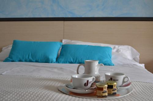 Letto o letti in una camera di Hotel La Siesta