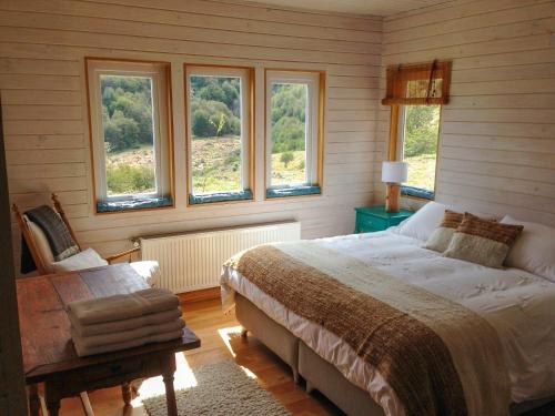 A bed or beds in a room at Casa Cerro Castillo
