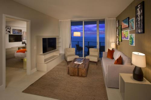 A seating area at Hyde Resort & Residences