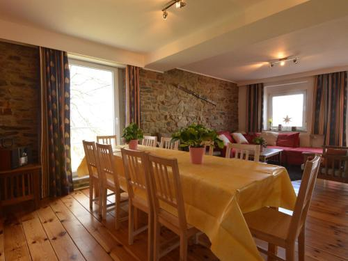 A restaurant or other place to eat at Beautiful Holiday Home in Heppenbach with Garden