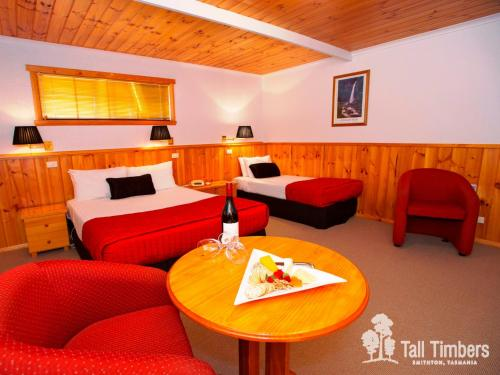 A bed or beds in a room at Tall Timbers Tasmania