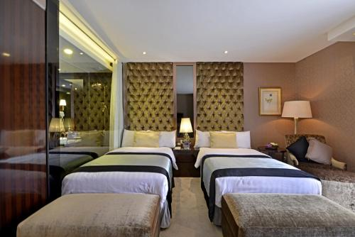 A bed or beds in a room at Amaroossa Grande