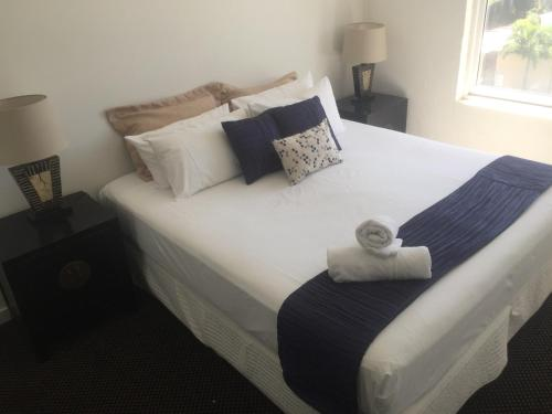 A bed or beds in a room at Sandcastles on the Beach Bargara