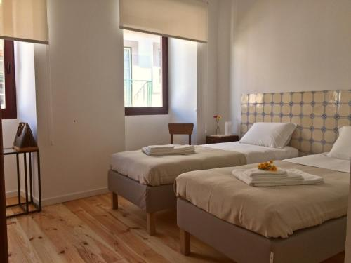 A bed or beds in a room at Casa Amarela