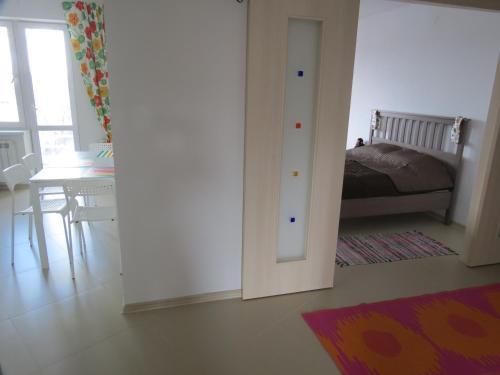 Кровать или кровати в номере Апартаменты на Ул. Лагерная, д. 5а