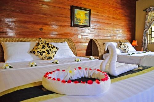 A bed or beds in a room at Atmaland Resort