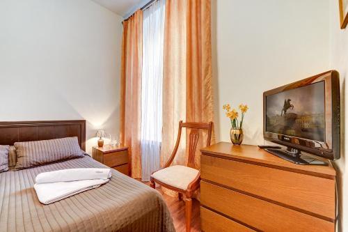 Кровать или кровати в номере Welcome