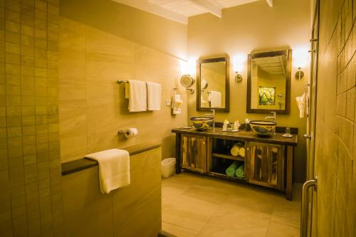 A bathroom at East Winds St. Lucia- All Inclusive