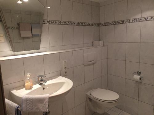 Een badkamer bij Hotel Raatz