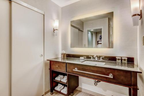 A bathroom at Homewood Suites by Hilton Indianapolis Carmel