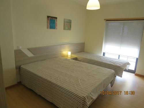 A bed or beds in a room at Casas do Zé Vila