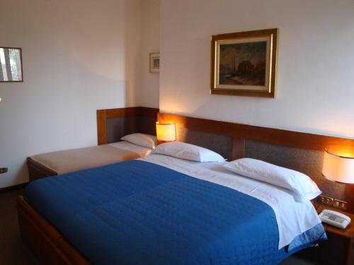 Letto o letti in una camera di Sporting Hotel Ragno D'oro