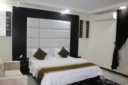 Cama ou camas em um quarto em Cloud and Stars Hotel