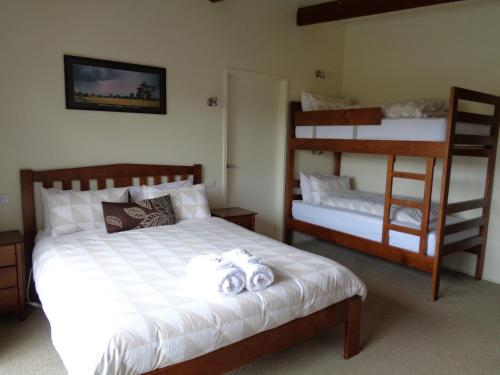 A bunk bed or bunk beds in a room at Off Mountain Accommodation