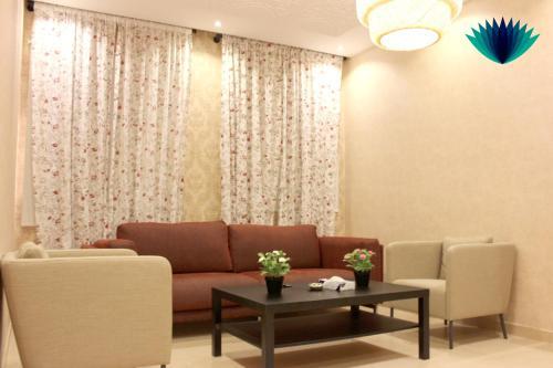 Uma área de estar em Tafasel Aparthotel