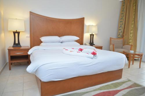 A bed or beds in a room at Old Vic Sharm Resort Families and Couples Only