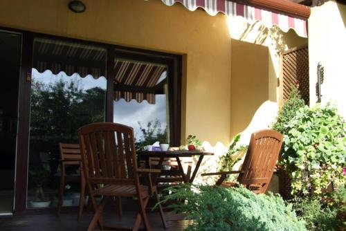 A porch or other outdoor area at Apartamentai Naglis
