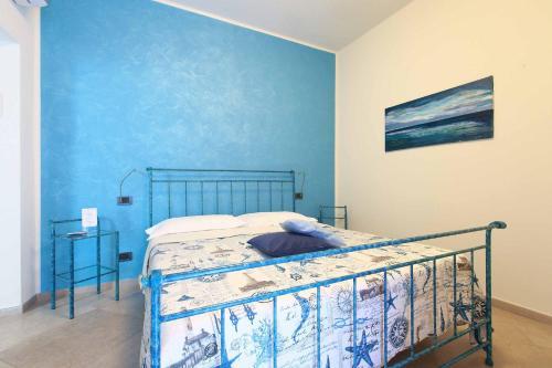 A bed or beds in a room at La Rosa Dei Venti