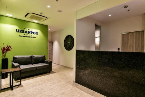 The lobby or reception area at Urbanpod Hotel