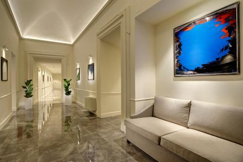 Ein Sitzbereich in der Unterkunft Locanda della Posta Boutique Hotel