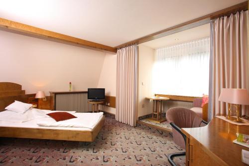 Ein Bett oder Betten in einem Zimmer der Unterkunft Hotel Brielhof