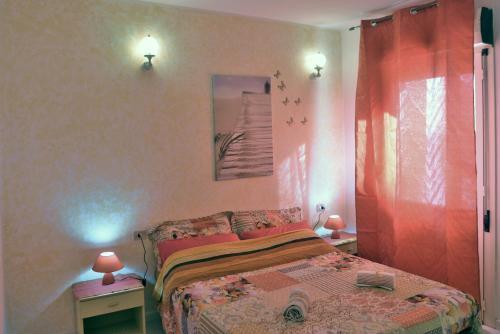 A bed or beds in a room at B&B Sa Pintadera