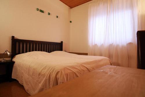 Ein Bett oder Betten in einem Zimmer der Unterkunft Ferienwohnung Pichler