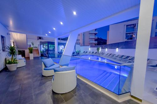 The swimming pool at or near Villamar Style Maison