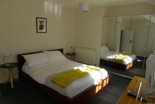 A bed or beds in a room at Totters Hostel