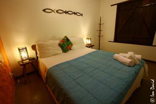 Cama ou camas em um quarto em Pousada Bambu Brasil