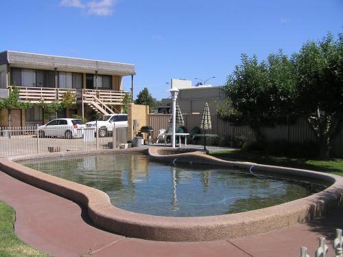 The swimming pool at or near Belltower Motor Inn