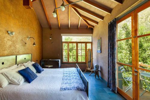 Cama o camas de una habitación en Hotel Altiplanico Cajón del Maipo