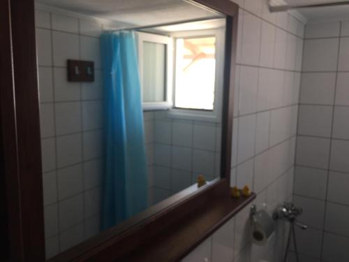 A bathroom at Popy Apartments
