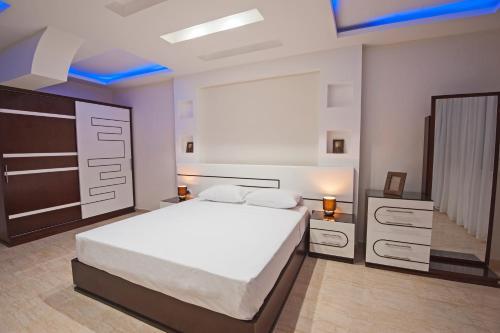 Lova arba lovos apgyvendinimo įstaigoje Sunny Seaside Villa