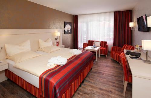 Ein Bett oder Betten in einem Zimmer der Unterkunft Ringhotel Posthotel Usseln