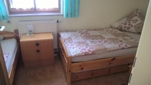 Ein Bett oder Betten in einem Zimmer der Unterkunft Wagnerhof