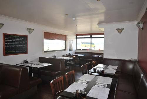 A restaurant or other place to eat at Saucy Mary's Hostel