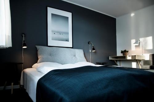 En eller flere senge i et værelse på Flinchs Hotel