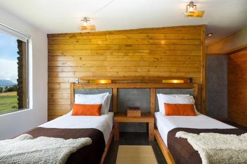 Cama o camas de una habitación en Hotel Altiplanico Puerto Natales