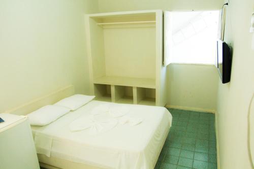 Cama o camas de una habitación en Pousada Valmar